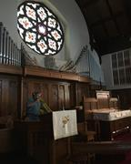 Henry Tiver working in sanctuary of Kemble Memorial United Methodist Church